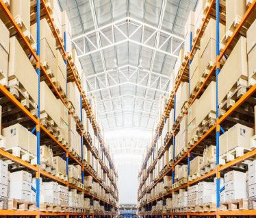 """Rows of shelves with boxes in modern warehouse Premium Photo"""