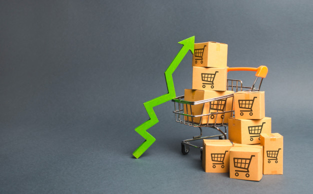 """""""Shopping cart with cardboard boxes with a pattern of trading carts and a green up arrow Premium Photo"""""""