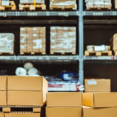 """""""Stack of cardboard boxes in smart warehouse industry logistic. Premium Photo"""""""