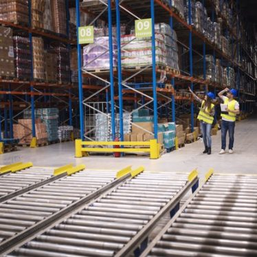 """""""Warehouse workers checking inventory and goods distribution in large storehouse Free Photo"""""""