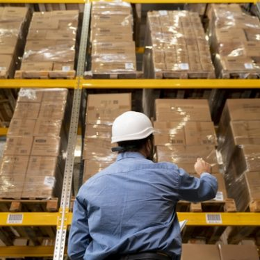 """""""Man with helmet working in warehouse Free Photo"""""""