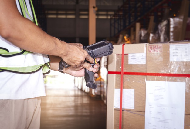 Warehouse worker using barcode inventory software